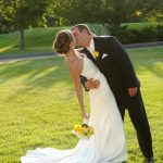 Bride and groom kissing at Mystic, CT
