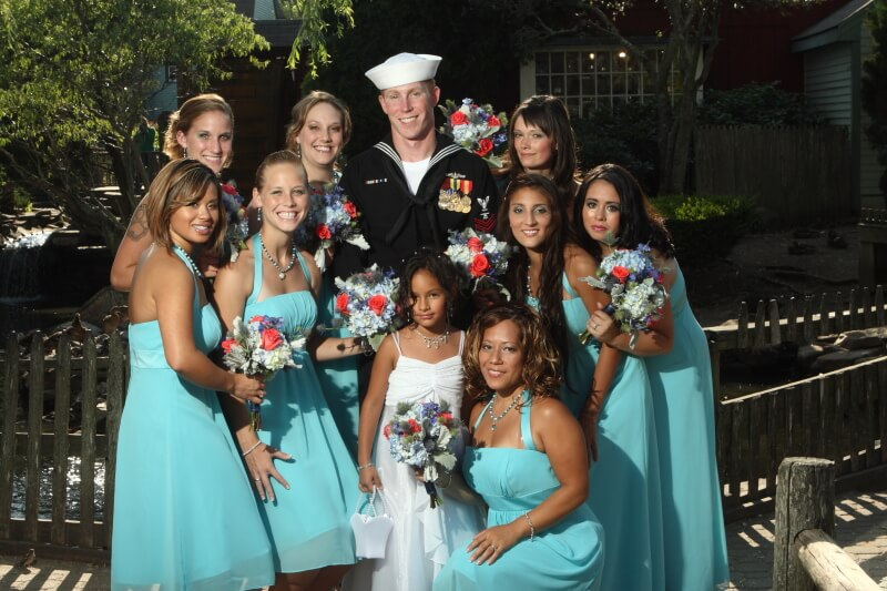Groom with bridesmaids at Old Mystic Village