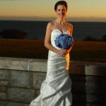 Bride holding flowers at sunset