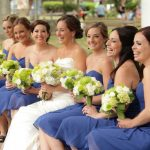 Laughing Bridal Party Holding Flowers Mystic Village