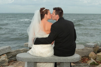 Romantic couple kissing on their wedding day