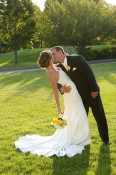 Groom and Bride kissing at wedding